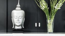 contemporary interior design detail with buddha image and flower